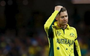 Australia's captain Michael Clarke reacts after wicket keeper Brad haddin missed a catch during his Cricket World Cup semi-final match against India in Sydney