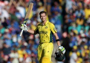 Australia's batsman Smith acknowledges the crowd after scoring his century during his Cricket World Cup semi-final match against India in Sydney